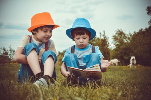 Two young boys reading