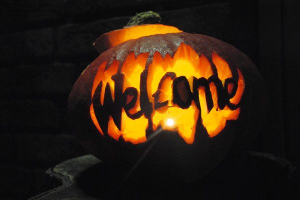 A pumpkin with welcome carved into it