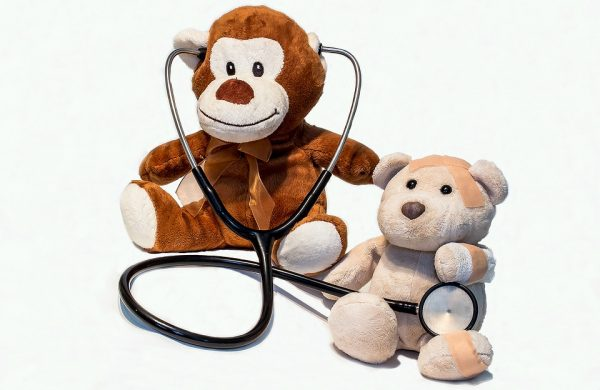 Two teddy bears acting as a doctor and patient