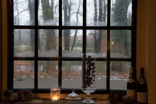 A window with a winter scene outside