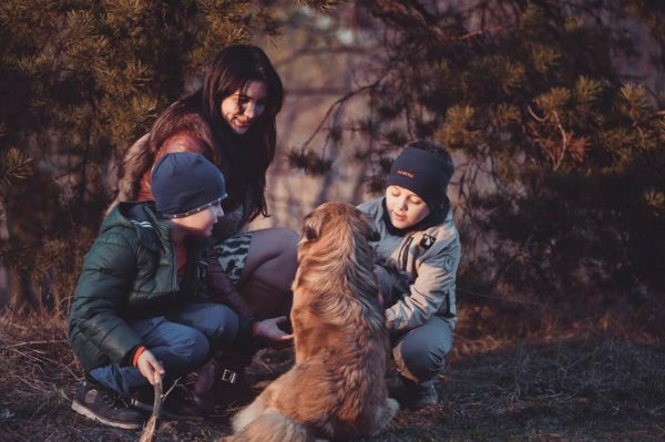 A family and dog in a forest