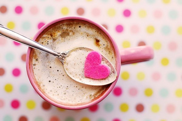 A spoon in a mug of hot chocolate