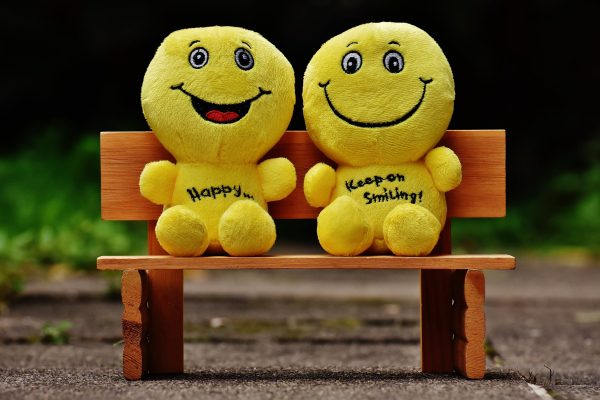 Two toys saying happy and keep on smiling