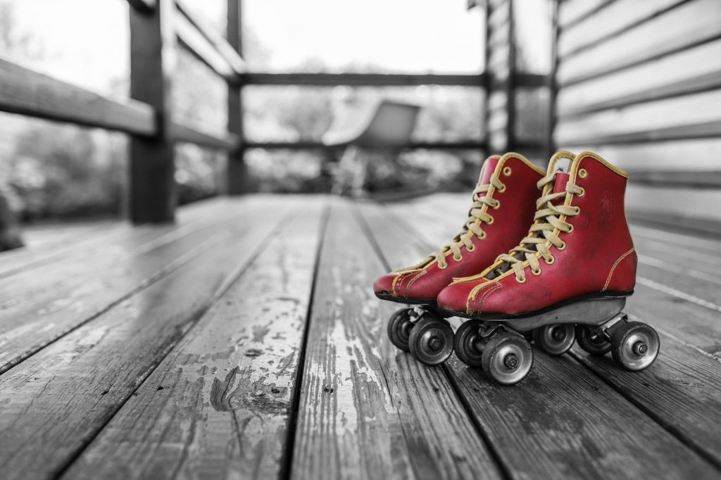 A pair of red roller skates