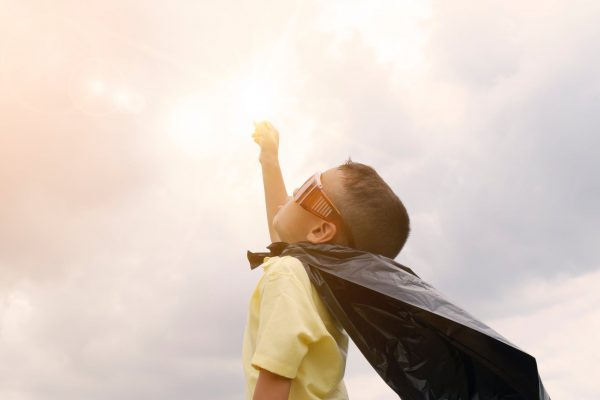 A boy dressed as a superhero
