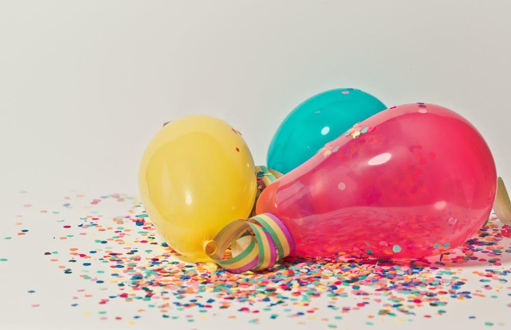 birthday balloons and confetti