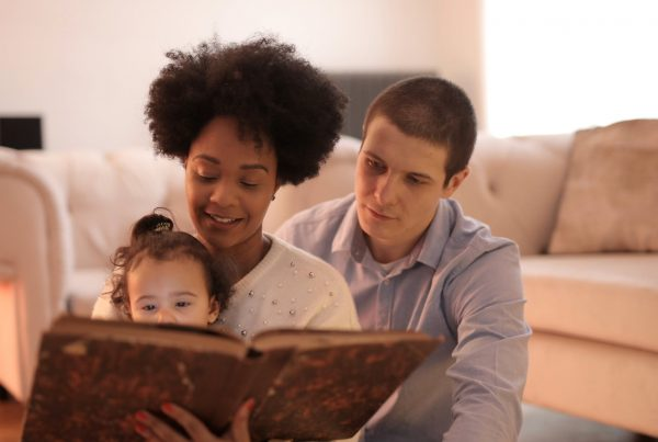 parents and baby reading