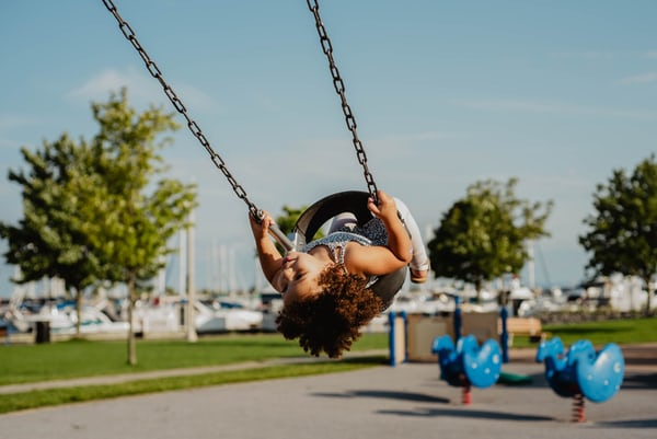a girl on a swing symbolising how to help your children adjust to life after lockdown