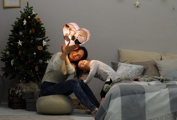 a mother and little girl at Christmas