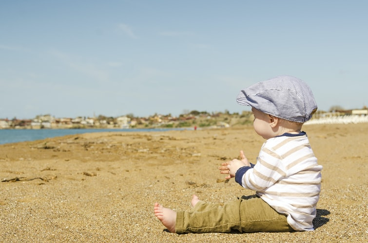 baby on the beach to represent why to take your baby outside