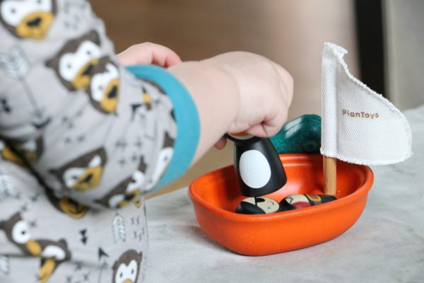 a toy boat to represent learning at home